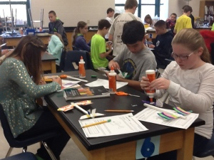 Students creating their airplanes.