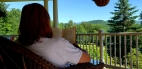 Mrs. Carbone is reading in the beautiful White Mountains.