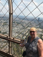 Mrs. Simonich, our Reading Specialist is reading at the Eiffel Tower in Paris!