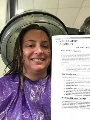 Mrs. Wilson reading while getting her hair done! Way to multi-task!